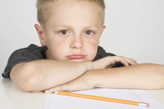 Schoolboy-doing-homework